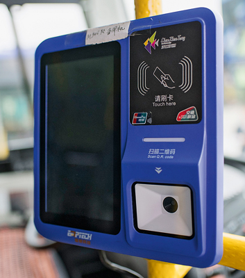 In Shenzhen's electric buses,  passengers use a smartcard to pay.