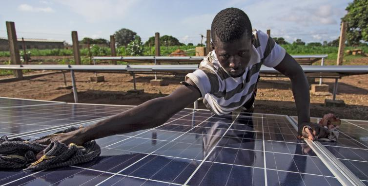 The ice machine works with solar power. Youssoufa Diouf cleans the solar panels every morning before the sun rises.